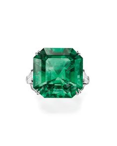 Harry Winston octagon emerald solitaire ring with tapered baguettes set in platinum, price upon request, HarryWinston.com.