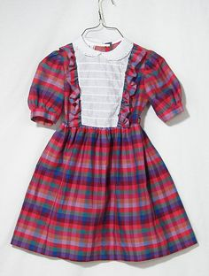 I had similar dresses to wear to school. Usually hand-me-downs from the neighbor families that mama would alter to fit me perfectly!