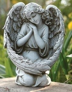 Guardian Angel Bird Feeder With Large Angel Wings. This angel is sure to attract the sweetest of birds. This pleasant Guardian Angel Bird Feeder is ideal for patio, garden or grave site. Made of Resin