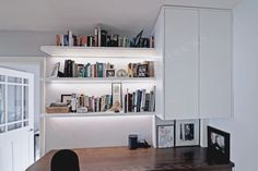 Bespoke home office design with integrated lighting and curved shelves