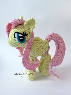 Fluttershy with closed wings.   Materials: 50g/200m wool, 2,5 hook, felt for eyes and cutie mark  High: 18cm, Width: 19cm