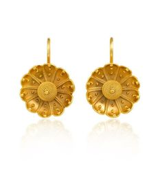A pair of antique gold earrings in the Etruscan style of stylized florette design, in 15k.