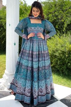 Sway away everyone with your simplicity as you wear this sea blue chanderi anarkali suit which will surely make a statement. This square neck and full sleeve clothe prettified with digital print work. Accompanied by a matching lycra churidar in sea blue color with sea blue chanderi dupatta Churidar has plain. #anarkalisuit #usa #Indianwear #Indiandresses #andaazfashion
