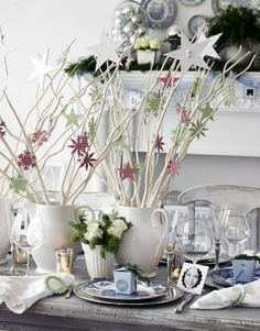 Pretty decorative arrangements with white twigs and stars