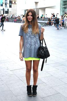 Gray printed t-shirt, neon yellow mini skirt and black high top shoes.