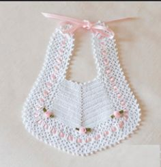 Babero Blanco con lazo Rosa y 3 flores Chevron patch and then edging ! Scarpina ballerina décolleté c A Soft Cream Knit Baby's Hat With Pink Satin by TheChildrensRoom Baby bibs, Purchase new child bibs inclusive of multipack bibs, coverall bibs, slow fa Crochet Baby Bibs, Crochet Baby Clothes, Crochet For Kids, Knit Crochet, Baby Hats Knitting, Baby Knitting Patterns, Baby Patterns, Crochet Patterns, Pattern Baby