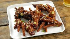Recipe with video instructions: Who knew this crunchy Korean bar food was also great for your skin? Ingredients: 1 lb chicken feet, 2 Tbsp kosher salt, ¼ cup soju, For the sauce:, 1 Tbsp gochujang, 2 Tbsp cheongyang gochugaru (extra-spicy gochugaru) or regular gochugaru, 1 Tbsp sugar, 1 Tbsp soy sauce, 1 Tbsp oyster sauce, 1 Tbsp mirin, 3 garlic cloves, chopped, ½ tsp grated ginger, 3 Thai chili, chopped, ¼ tsp black pepper, To garnish:, Green onion, Sesame seeds, Sesame oil
