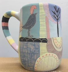 I'm loving this new series of mugs - Collaged Cups. Looking forward to firing and seeing how all the colors interact! Fun times in the studio!