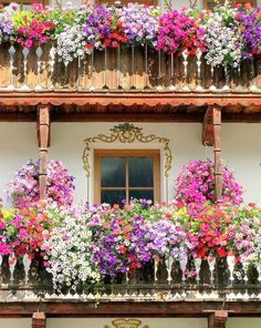 a balcony overflowing with flowers