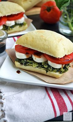 Caprese Sandwich | by Life Tastes Good is a simple recipe that is big on flavor! The softest, most delicious ciabatta roll topped with fresh basil pesto, tomatoes, and creamy mozzarella cheese all dri (Picnic Sandwich Recipes)