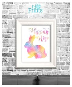 Youll love this adorable Easter Print, featuring an adorable watercolor Easter bunny and the words Hippity Hop! This lovely Easter decor has lovely pastel watercolors and will lovely in your home and remind you of spring!  Do you love this print? Please check out the other home décor prints and greeting cards we offer at KFPrints! http://etsy.com/shop/kfprints  -Why Buy Printables- Printable from KFPrints are the way to go if youre looking for a way to spice up your home f...