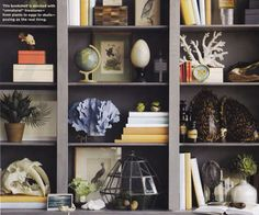 Love both the color and the styling of these bookcases.