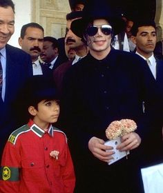Michael with Omer Bhatti :) He always loved babies and all children of the world ღ by ⊰@carlamartinsmj⊱