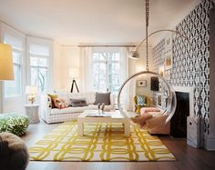 add texture and color with one accent wall and area rug. BONUS: bubble swing!