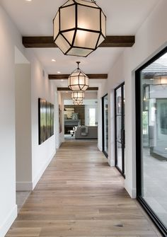 Hall Lighting. Repeating lights down and expansive hallway is a great way to showcase the drama of a lengthy space. #Hall #lighting #lightfixture #hallway  Denise Morrison Interiors