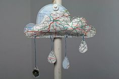 Paper cloud with raindrops artwork in a map by BettyandRoland