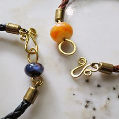 Lucinda Storms : Belvedere Beads - lampwork & leather bangles (clasp detail)