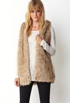 Just the thing to keep warm this winter!  Favorite Faux Fur Vest - Lyst