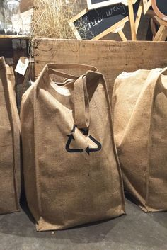 Burlap recycling tote for an organized and green home.