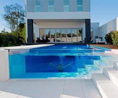 Glass side pool. like having sea world in your backyard!