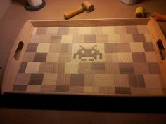 Veneered mahogany, cherry, birch and oak tray with space invader detail. # wood design