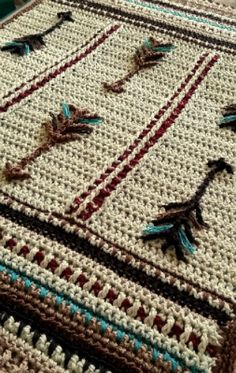 Native American inspired crochet blanket. Arrows represent protection. Baby blanket or lap afghan. gsmdsigns