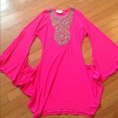 Dress hot Pink Super Sexy 95% polyester 5% spandex great with leggings or with out. One small spot on front May washout I never tried can really notice it never worn.  Bottom lands on thigh area.  All ready to go I will ship same day order placed by 6 p m after 6pm by 9 am the flowing day. Dresses