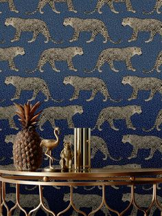 This stunning Leopard Wallpaper would make a unique and stylish feature in your home. The design features a repeat pattern of beautifully detailed leopards in metallic gold, set on a leopard print patterned background in tones of navy blue. Easy to apply, this high quality wallpaper has a beautiful metallic sheen finish and will look great when used to decorate a whole room or to create a feature wall. This colourway is exclusive to World of Wallpaper and can not be found on the high street. Leopard Wallpaper, Animal Print Wallpaper, Blue Gold, Navy Blue, Metallic Gold, Wild Creatures, Pattern Matching, Paper Wallpaper, High Quality Wallpapers