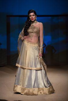 Ashima Leena silver gold lehnga. More here: http://www.indianweddingsite.com/bmw-india-bridal-fashion-week-ibfw-2014-ashima-leena/