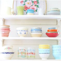 Open shelving in a kitchen is a great way to bring in color and a whole lotta' cuteness!
