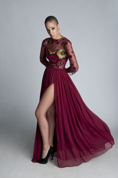 Another Kaela Kay FW2013 collection piece. Floor length gown featuring sheer lace sleeves, sheer lace midriff and front thigh high slit.