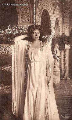 Queen Marie of Romania In her Moorish chamber at the Cotroceni Palace. This classic-inspired dress is impossible to date, but it shows Marie's flair for theatrical dress
