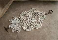 Use lace from mom's wedding dress or left over fabric to make a bracelet or other accessory?