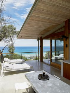 Like the simple deck 2nd floor. and doors. unfortunate pipe/drain  on corner.The Ocean House - Rob Mills Architects