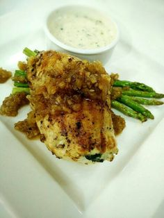 """Stuffed Chicken Breast""  Grilled chicken breast stuffed with creamy spinach serve with sauteed asparagus and white sauce."