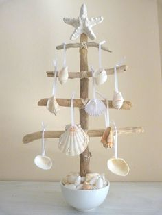 I LOVE this Beach themed Christmas Tree made from reclaimed beach driftwood. The Christmas ornaments fashioned from found beach sea shells add the perfect touch! ~ ♥