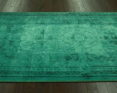 Project Nursery - over dye rug in green