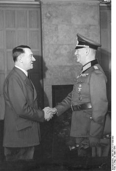 Adolf Hitler shaking Wilhelm Keitel's hand, 9 Mar 1941. Keitel is carrying his field marshal's baton and has his familiar lackey's smile painted on his face. Hitler's Yes-Man par excellence, Keitel lived the life of the daily sycophant throughout the war. For all of his troubles, he was sentenced to death at Nuremberg and hanged in October 1946.