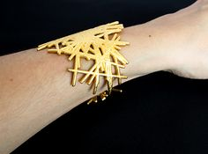 Lines Bracelet 3d printed Mathematical Art Bracelets by Geek Prints.  Polished Gold Steel.  Enrobed in 24k gold and polished to a mild sheen with visible print lines.
