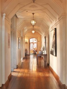if you're going to have a hallway, you might as well do it right!  the baseboard is so prettily matching the floor here.