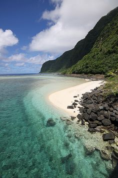 Turquoise water, green mountains and white sand, American Samoa