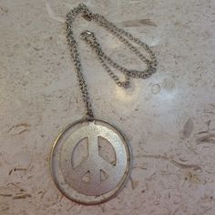 Silver peace sign necklace Long chain with adjustable clasp in good condition Forever 21 Jewelry Necklaces