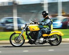 A Sailor rides a motorcycle Feb. 10 at Joint Base Pearl Harbor-Hickam while following Navy safety procedures and protocols.  U.S. Navy photo...