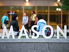 Students outside Founders Hall on the Arlington Campus. George Mason University.