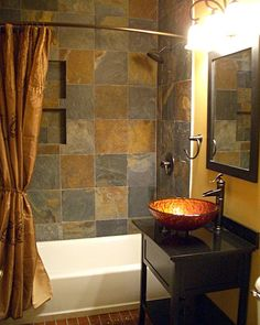 Small Bathroom – Copper and Slate ~ Metallics reflect light, enabling the use of dark colors in small spaces.