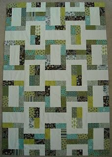 A modern quilt made with a jelly roll
