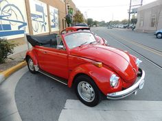 """Billy R Wilson III's red VW cabriolet.  Billy is father of 6 """"kids"""": 3 kids and 3 VW classics...  Billy is from Kohomo, Indiana, U.S.A."""