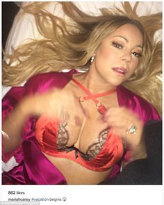 Showed what she's got: The 46-year-old songstress lay back on a white pillow…