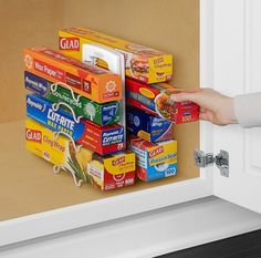 Get an organizer for all those boxes of foil, wax paper, and plastica wrap that are always jamming up your drawers.