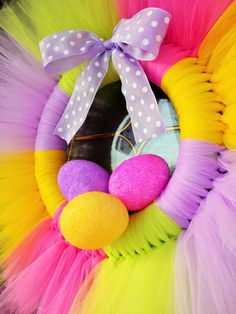 Pretty pastel colored Easter wreath complete with glitter Easter eggs